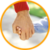 image of parent holding special needs child's hand