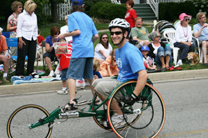 image of jason stubbeman in a wheelchair racing